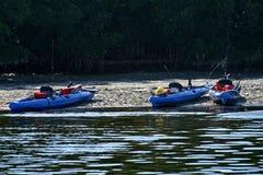 Three Beached Blue Kayaks Stock Photography