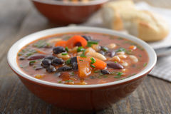 Three bean soup. On a rustic table Stock Photography