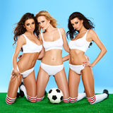 Three beautiful athletic women in lingerie Stock Photos
