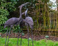 Three beautiful bird statues in a garden, backyard decorations, gardens in japanese style. Three beautiful bird statues in a garden, backyard decorations, a stock photos