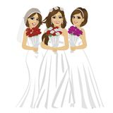Three beautiful brides wearing different bride dresses posing with bouquet of roses Royalty Free Stock Photos