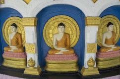 Three beautiful buddhist statues at the altar in the temple. At Colombo in Sri Lanka stock images