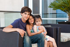 Three beautiful children sit happily together Royalty Free Stock Photography