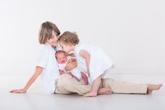 Three beautiful children in white studio Royalty Free Stock Photos