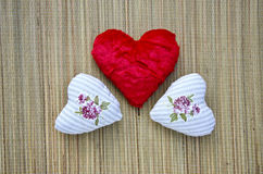 Three beautiful cloth hearts on table Royalty Free Stock Photography