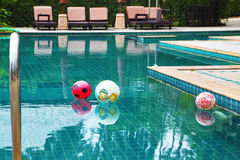 Three beautiful colored balls in the pool Stock Image