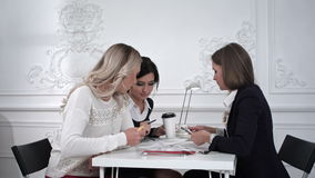 Three beautiful creative business woman working with documents in office stock video