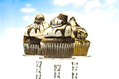 Three beautiful cupcakes and sky Royalty Free Stock Image