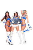 Three beautiful dancers with dj controller. Isolated on white background Stock Photo