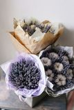 Three beautiful and different bouquets lavender on table . dried flowers lilac color. placed in a paper bag. Beautiful bouquet lavender on table . dried flowers royalty free stock images
