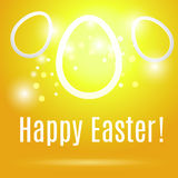 Three beautiful Easter contour eggs  on a yellow background with. Glow and bokeh particles  and inscription happy Easter Royalty Free Stock Photo