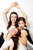 Three beautiful fashionable girls having fun isolated on white Stock Images