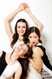 Three beautiful fashionable girls having fun isolated on white Stock Images