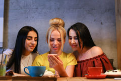 Three beautiful female use phone Stock Images