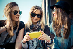 Three beautiful friends authentic. In urban contest Royalty Free Stock Photo
