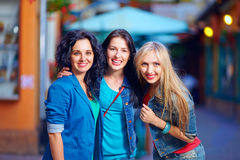 Three beautiful friends on evening street Stock Image