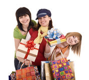 Three beautiful girlfriends enjoy shopping. Royalty Free Stock Image