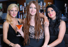 Three beautiful girls in bar Royalty Free Stock Photography