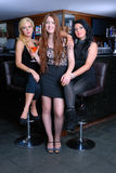 Three beautiful girls in bar Royalty Free Stock Photo