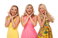 Three beautiful girls in fashion dresses Stock Image