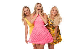 Three beautiful girls in fashion dresses Stock Images