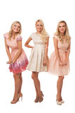Three beautiful girls in fashion dresses isolated Royalty Free Stock Photography