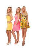 Three beautiful girls in fashion dresses Royalty Free Stock Photo