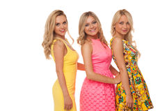 Three beautiful girls in fashion dresses Royalty Free Stock Photos