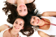 Three beautiful girls on the floor Stock Photography