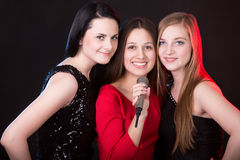 Three beautiful girls with microphone Royalty Free Stock Photos