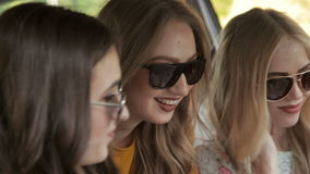 Three beautiful girls are paving the route on the map for future trip stock video