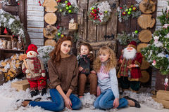 Three beautiful girls posing in Christmas decorations Royalty Free Stock Images