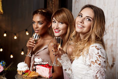 Three beautiful girls resting at party. royalty free stock photo