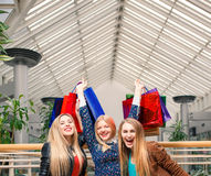 Three beautiful girls with shopping bags Royalty Free Stock Images