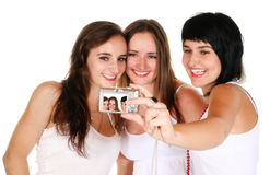 Three beautiful girls taking a photo Royalty Free Stock Photo
