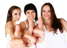 Three beautiful girls with thumbs up Stock Images