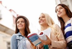 Three beautiful girls with tourist book in city Stock Images