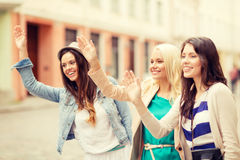 Three beautiful girls waving hands Stock Photo
