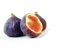 Three beautiful healthy fig isolated Royalty Free Stock Photography