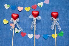 Three beautiful heart candies background royalty free stock image
