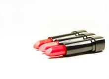 Three beautiful lipsticks  on white Royalty Free Stock Photography