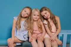 Three beautiful little girls dresses fashion portrait sisters royalty free stock photo