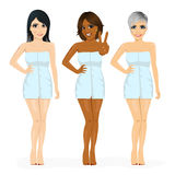 Three beautiful multiracial women with different skin tone color wrapped in blue towel Stock Photos