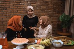 Muslim woman talk to each other while dinner