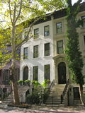 Three elegant New York City townhouses. A row of three brownstones on the Upper East Side of Manhattan Royalty Free Stock Photography