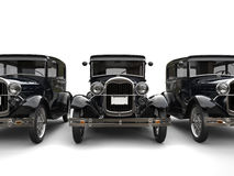 Three beautiful 1920s vintage cars - front view cut shot. Isolated on white background Stock Photography