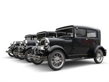 Three beautiful 1920s vintage cars - perspective shot. Isolated on white background Stock Photography