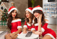 Three beautiful Santas Stock Image