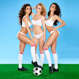 Three beautiful women soccer players stock photo