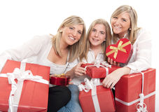 Three beautiful sisters with presents Royalty Free Stock Image